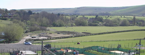The site before the 2 agricultural barns were built . Now there will also be a very large building added to the valley.